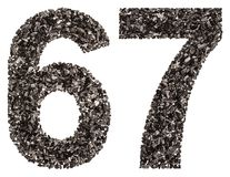 Arabic numeral 67, sixty seven, from black a natural charcoal, i Stock Photo