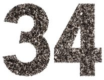 Arabic numeral 34, thirty four, from black a natural charcoal, i Stock Images