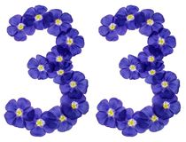 Arabic numeral 33, thirty three, from blue flowers of flax, isol Stock Photography