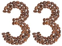 Arabic numeral 33, thirty three, from coffee beans, isolated on Royalty Free Stock Images