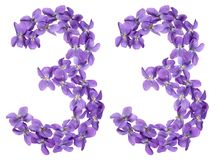 Arabic numeral 33, thirty three, from flowers of viola, isolated. On white background Stock Images