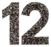 Arabic numeral 12, twelve, from black a natural charcoal, isolated on white background stock photography