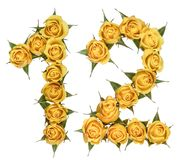 Arabic numeral 12, twelve, from yellow flowers of rose, isolated. On white background stock images