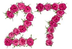 Arabic numeral 27, twenty seven, from red flowers of rose, isolated on white background royalty free stock image