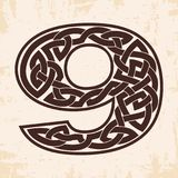 Numeral with Celtic ornament. Arabic numerals with Celtic national ornament as interlaced ribbon on a beige background. Paryrus with the aging effect Royalty Free Stock Images