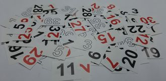 Arabic numerals in white, black and red. Heap of mixed scattered numbers stock photography