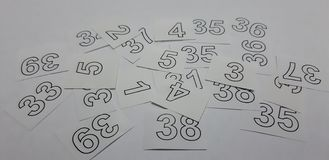 Arabic numerals in white. Heap of mixed scattered numbers royalty free stock image