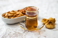 Arabic, oriental tea with cashew and dry figs Royalty Free Stock Image