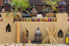 Arabic outdoor kitchen at restaurant decorated with canned food. Arabian outdoor kitchen at restaurant decorated with stones and tinned food Royalty Free Stock Photo