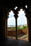 Arabic palace of the Alcazaba, Malaga, Andalusia, Spain. View of seaport of Malaga from inside the Alcazaba palace, Andalusia, Spain Royalty Free Stock Photo