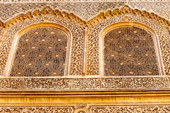 Arabic Palace Ben Youssef. Wall with windows of Arabic Palace Ben Youssef in Marrakech, Morocco Royalty Free Stock Photo