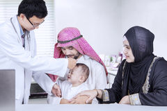 Arabic parents and doctor checkup their baby Stock Images