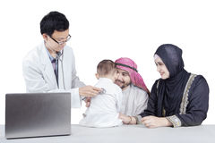 Arabic parents and his kid visit doctor Royalty Free Stock Photos