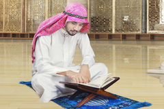Arabic person reading Quran in mosque Royalty Free Stock Image