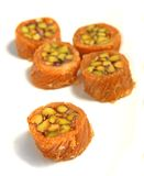 Arabic pistachio burma pastries. Traditional Arabian pistachio burma pastries on a plate, extreme close-up. These sweets, filled with pistachios, are given on Stock Images