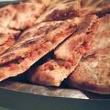 Arabic pizza slices. With tomato royalty free stock photography