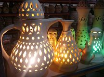 Arabic pots. Unfinished arabic decorative pots and tea pots. Outdoor pottery market. Lights added to the beauty Stock Photography