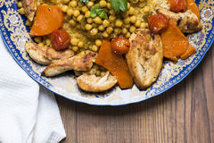 Arabic recipe with couscous and chicken breast. Royalty Free Stock Photography