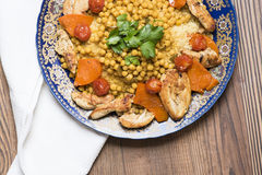 Arabic recipe with couscous and chicken breast. Stock Photo