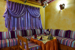Arabic restaurant. Luxurious romantic table setting in a traditional arabic restaurant, Morocco Stock Photo