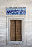 Arabic script Tile and door, Suleymaniye Mosque. The Süleymaniye Mosque was built on the order of Sultan Süleyman (Süleyman the Magnificent). It is in Stock Photography