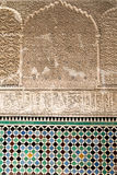 Arabic script on walls of the Bou Inania Madarsa in Fes, Morocco. Royalty Free Stock Image