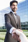 Arabic businessman shaking hands with person Royalty Free Stock Image