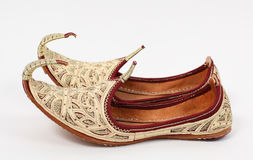 Arabic shoes. Traditional Arabic shoes over white background Royalty Free Stock Photos