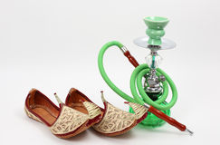 Arabic shoes and water pipe Royalty Free Stock Photo
