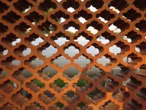 Arabic style garden wall. Brown terracotta Arabic style garden wall Stock Photos