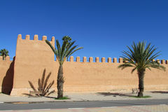 Arabic style medival castle walls in the city Stock Photos