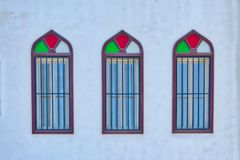 Arabic style three windows. Old, colorful arabic style windows in triplets - Muscat, Oman Royalty Free Stock Photo