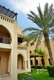 The arabic style villa with green lawn and palm tree in luxury hotel stock photo