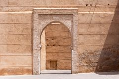 Arabic style wall door on a Marrakech street royalty free stock photo