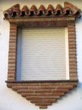 Arabic style window. Brick suround arabic style window with closed white blinds Royalty Free Stock Photo