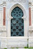 Arabic style window in Istanbul. Arabic style carving blue window of a house in Istanbul Royalty Free Stock Images