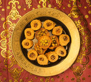 Arabic sweet- Kunafa. Arabic sweet- Baklava in a golden plate Royalty Free Stock Photography