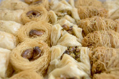 ARABIC SWEET PASTRIES. Dessert.ARABIC SWEET PASTRIES with honey Stock Image