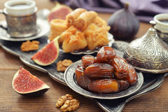 Arabic sweets. Baklava, figs, nuts and dry dates on tray. Small shallow DOF Stock Image