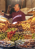 Arabic sweets. Man selling Arabic sweets on a shelf of the souks of Marrakech in Morocco is an image vertical. It´s a editorial picture Royalty Free Stock Photos