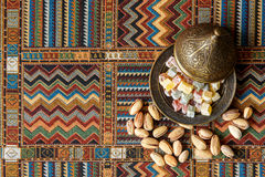 Arabic sweets on the traditional Persian rug. Sweets on the traditional Arabian carpet Stock Image