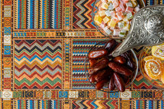 Arabic sweets on the traditional Persian rug. Sweets on the traditional Arabian carpet Stock Images