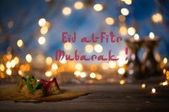Arabic sweets on a wooden surface. Eid al-Fitr Mubarak. Feast for breaking Ramadan fasting Royalty Free Stock Photos