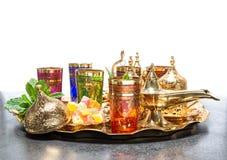 Arabic tea coffee service golden cups lantern Ramadan. Arabic tea coffee service with golden cups and lantern. Ramadan kareem. Holidays decoration Stock Images