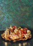 Arabic tea coffee table Ramadan kareem vintage. Arabic tea coffee table golden dishes. Oriental hospitality. Ramadan kareem. Vintage style toned picture Stock Photo