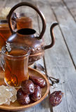 Arabic tea and dates background Stock Photos