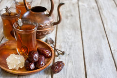 Arabic tea and dates background Royalty Free Stock Photos