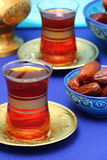 Arabic tea and dates. Dates and tea for Ramadan Stock Images