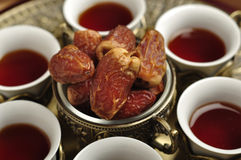 Arabic tea and dates. Royalty Free Stock Photos