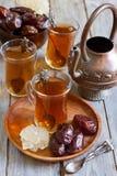 Arabic tea and dates Stock Photo